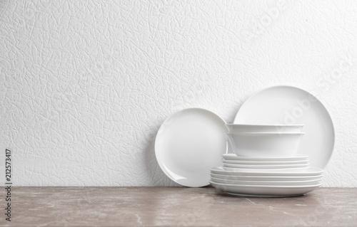 Set of new ceramic dishware on table Fototapete