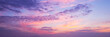 Leinwandbild Motiv Panoramic view of a pink and purple sky at sunset. Sky panorama background.