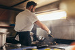 canvas print picture - Male cook preparing a dish in food truck