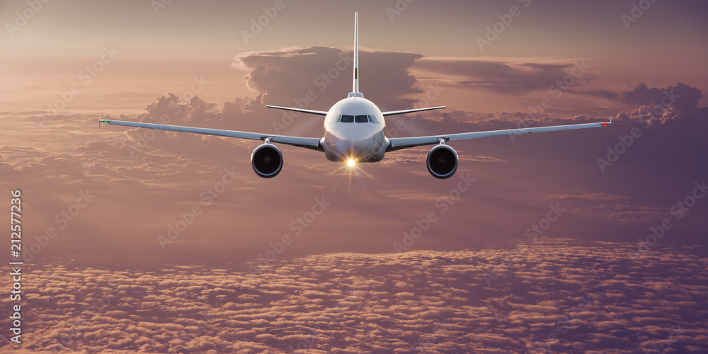Fototapety, obrazy: Commercial airplane flying above clouds.