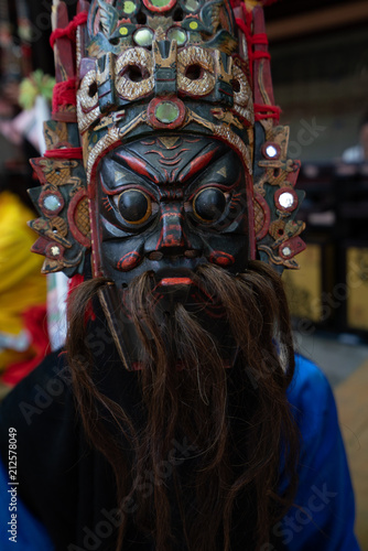 Deurstickers Asia land Miao person wearing traditional mask