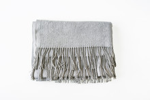 Gray Cashmere Female Scarf Folded In A Rectangle On A White Background. Minimalism. Top View, Flat Lay
