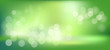 green abstract blur bokeh background with blurry white circles