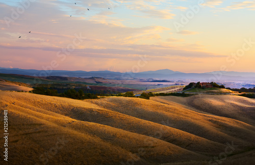 Deurstickers Toscane typical Tuscany landscape; sunset over rolling hills and Tuscany village