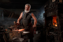 Blacksmith With Brush Handles The Molten Metal
