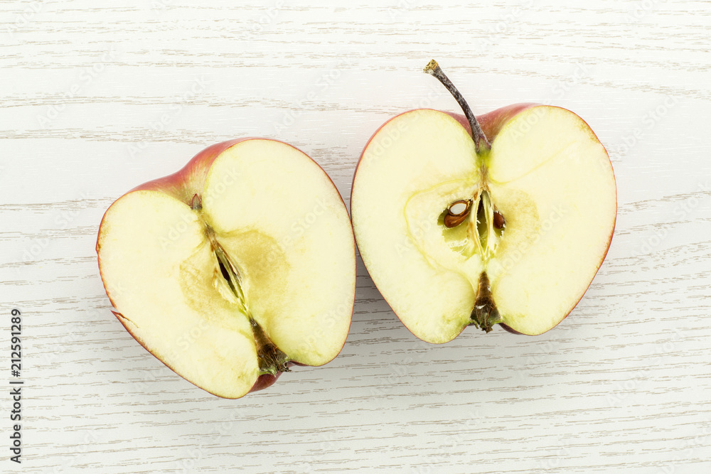 Photo  Red delicious apple two section halves flatlay on grey wood background