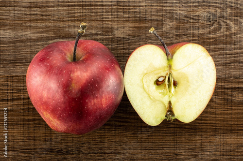 Photo  Red delicious one apple and section half flatlay on brown wood background