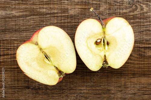 Photo  Red delicious apple two section halves flatlay on brown wood background