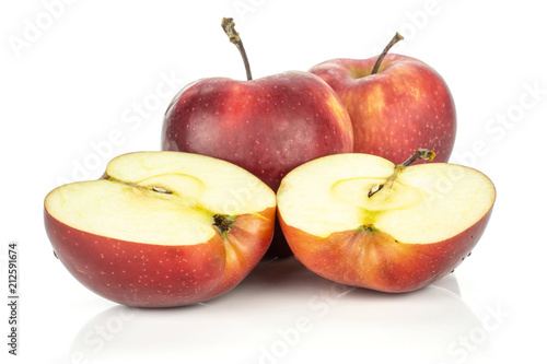 Photo  Two red delicious apples and two halves isolated on white background cross section