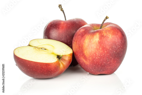 Photo  Two red delicious apples with a half isolated on white background cross section