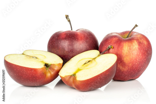 Photo  Two red delicious apples with two halves isolated on white background cross section