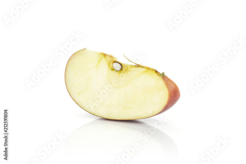 Photo  One red delicious apple slice isolated on white background.
