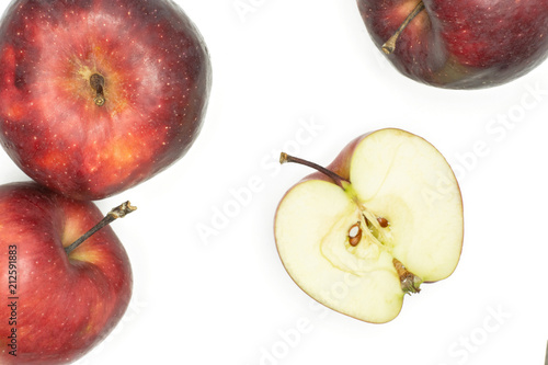 Photo  Red delicious three apples and one half flatlay isolated on white background