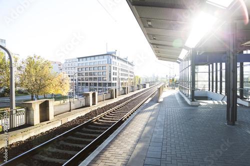 Montage in der Fensternische Bahnhof beautiful modern empty train station in the sun light of sunset