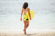 Surfing surfer woman girl walking holding surfboard. Water sport summer vacation travel concept.