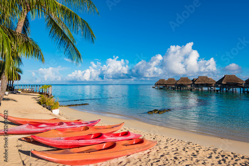 Foto op Canvas Oceanië Paradise tropical beach with empty kayaks. Moorea, French Polynesia.