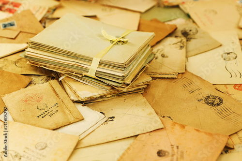 Fototapeta Many old paper mail letters. Envelopes are stamped: