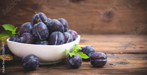 Fresh organic plums in the bowl