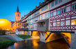 Leinwanddruck Bild Historic city center of Erfurt with Krämerbrücke bridge illuminated at twilight, Thüringen, Germany