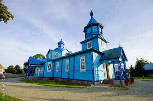 Poster Historisch geb. Blue wooden church in Narew, Poland