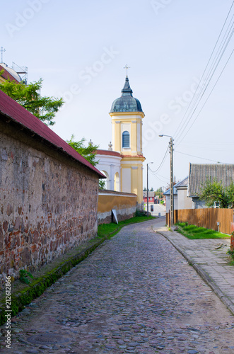 Poster Historisch geb. Wall and church in Tykocin, Poland