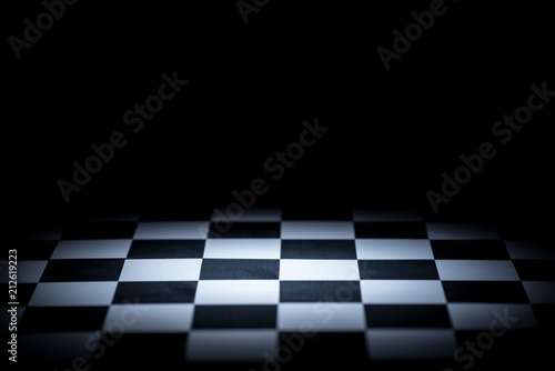 Canvas Print abstract chessboard on dark background lighted with snoot