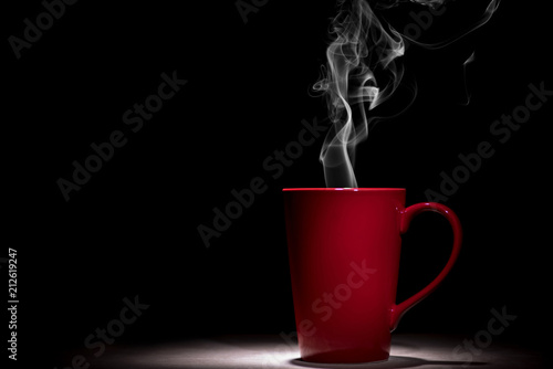 Wall Murals Cafe red coffee cup with smoke on black background