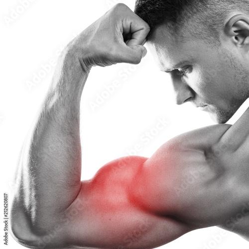 Vászonkép Young muscular man showing his bicep