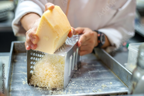 Chef grating cheese