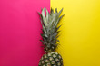 canvas print picture - Pineapple on colorful a yellow-pink background. Minimal summer concept.