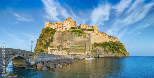 Spoed Foto op Canvas Europa Sunset view of Aragonese Castle near Ischia island, Italy