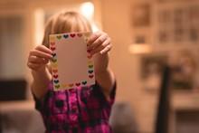 Girl Holding Heart Shape Valentine Card