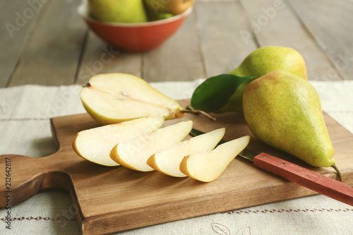 Cut pears on wooden board