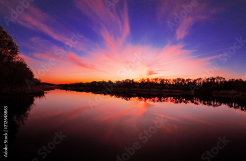 Spoed Foto op Canvas Violet Sunset over the lake at the village