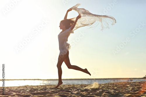 Obraz Beautiful sexy woman at dusk on the beach - fototapety do salonu
