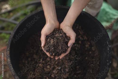Female farmer holding a soil