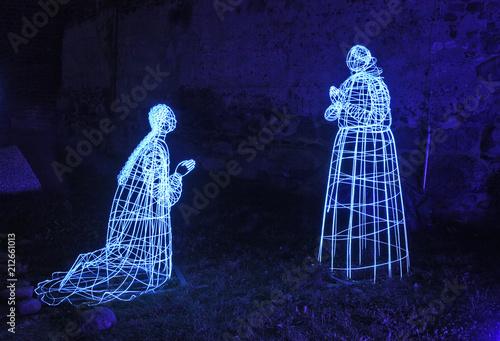 Festival of light. Historical figures at Torun castle. Poland