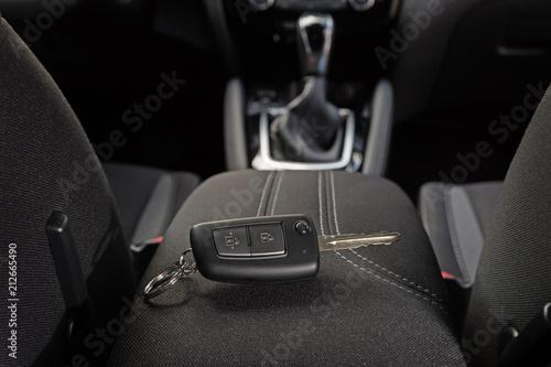 key lies inside the car's interior on the armrest Canvas Print