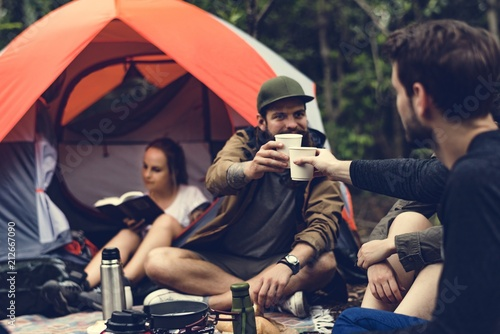 Obraz Friends camping in the forest together - fototapety do salonu