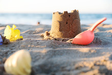 Sand Castle On Beach. Summer Vacation Concept Background
