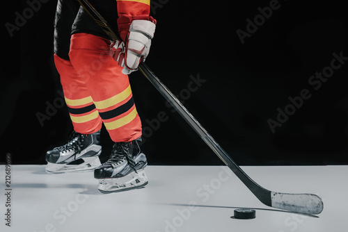 low section of professional sportsman playing hockey on black Wallpaper Mural