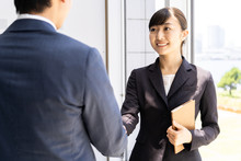 Asian Businessgroup Shaking Hands