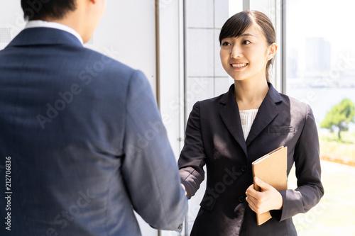 asian businessgroup shaking hands Wallpaper Mural