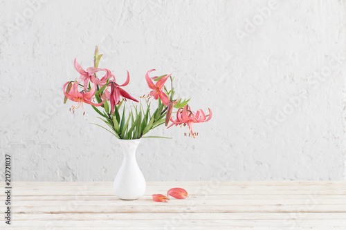lily in vase on background white wall