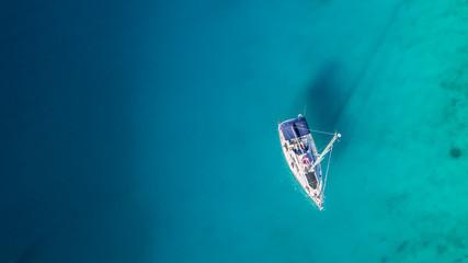 Fototapeta Sailing boat anchoring in Croatia bay, aerial view.