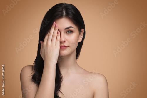 Obraz na plátně Cute woman covering eye with hand