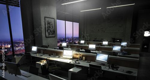 Photo  Bürokomplex - Großraumbüro mit mehreren Arbeitsplätzen am Abend