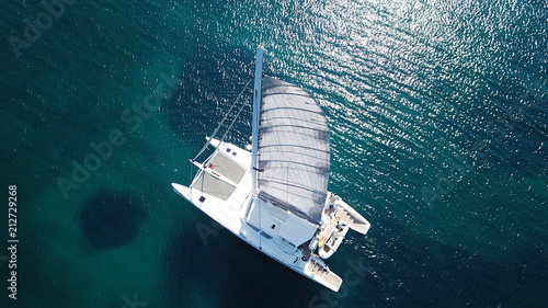 Fototapeta Aerial drone bird's eye view photo from luxury Catamaran docked at tropical deep
