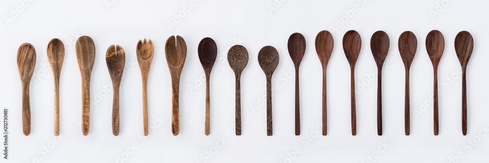 Fototapeta Kitchenware set of wooden fork, spoon and utensils on white background.