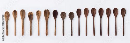 Fototapeta Kitchenware set of wooden fork, spoon and utensils on white background. obraz